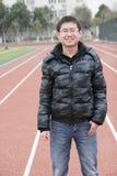 Sorrisos do homem novo de Asain Fotos de Stock