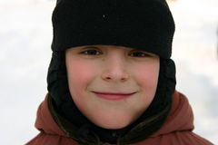 Sorrisos do menino Imagem de Stock