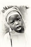 Sorrisos ganeses pequenos da menina Fotos de Stock Royalty Free