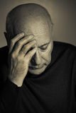 Sorrow. Portrait of the sad elderly man Royalty Free Stock Images