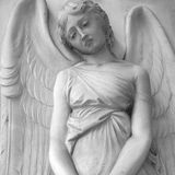 Sorrow. Sad cemetery angel relief on monumental italian churchyard,Staglieno Genoa, Italy, Europe Stock Photography