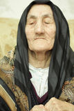 Sorrow. Very old woman closed eyes in sorrow Royalty Free Stock Images