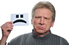 Sorrow man with card Stock Images