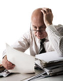 Sorrow of old accountant. Senior man with a heap of documents stock image