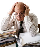 Sorrow of old accountant. Elderly man with a heap of documents royalty free stock photos