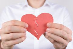 Sorrow sad unhappy upset negative concept. Cropped close up photo of tired exhausted guy trying to connect unite join tie two. Parts of broken heart isolated royalty free stock photos