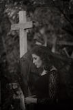 Sorrow. Young woman in the cemetary Royalty Free Stock Images