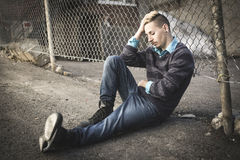 Sorrowful adult on the City Street. A Sorrowful young adult on the City Street Stock Photography
