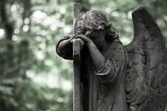 The Sorrowful Angel. Weeping angel with a cross, space for text. The Sorrowful Angel. The tomb of the 19th century, the German introduced city of Moscow.Weeping royalty free stock images