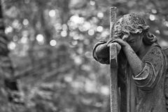 The Sorrowful Angel. Weeping angel with a cross, space for text. The Sorrowful Angel. The tomb of the 19th century, the German introduced city of Moscow.Weeping stock photography