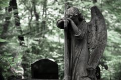 The Sorrowful Angel. Weeping angel with a cross, space for text. The Sorrowful Angel. The tomb of the 19th century, the German introduced city of Moscow.Weeping stock images