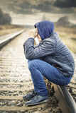 Sorrowful boy on the railway Royalty Free Stock Photo