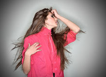 Sorrowful brunette woman dressed in pink blouse. With long hairs, ring flash studio portrait on white Royalty Free Stock Photography