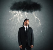 Sorrowful businessman. Desperate businessman with cloud over his head Stock Images
