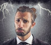 Sorrowful businessman. Portrait of sad businessman with storm background Stock Image