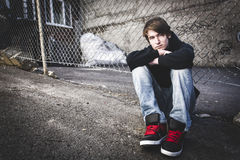 Sorrowful Kid on the City Street. A Sorrowful Kid on the City Street Stock Photo