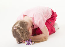Sorrowful little girl on the floor Royalty Free Stock Photo