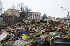 Sorrowful Maidan filled with flowers and candles. Kyiv, Ukraine - March 01 2014: Maidan's barricade is covered with a lot of flowers. Ukrainian capital is Royalty Free Stock Image