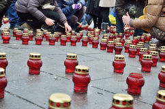 Sorrowful Maidan filled with memorial candles Stock Photo