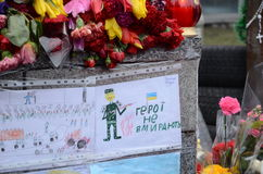 Sorrowful Maidan. Kiev, Ukraine - March 01 2014: Maidan are covered with flowers and children's drawings. Ukrainian capital is sorrowing over victims of the Royalty Free Stock Image