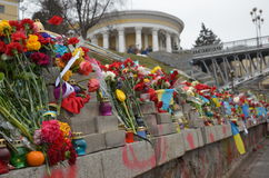 Sorrowful Maidan. Kyiv, Ukraine - February 22 2015: Maidan are covered with flowers. Ukrainian capital is sorrowing over victims of the shooting at the Royalty Free Stock Photos