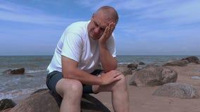 Sorrowful man near sea stock footage