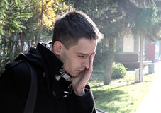 Sorrowful Man Outdoor. Portrait of Sorrowful Man in the Autumn Park stock photos
