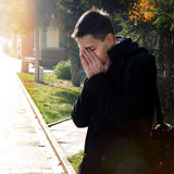 Sorrowful Man outdoor. Portrait of Sorrowful Man in the Autumn Park Stock Photo