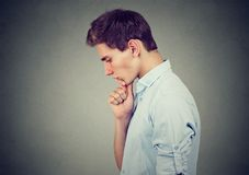 Sorrowful man thoughtful looking down. Sorrowful young man thoughtful looking down Stock Photography