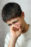 Sorrowful Teenager. Sorrowful Young Teenager crying on gray background Stock Photography