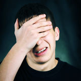 Sorrowful Teenager. On The Dark Background royalty free stock photo