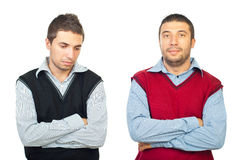 Sorrowful two men. Standing with arms folded and thinking isolated on white background,check also Business people Royalty Free Stock Photos