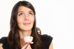 Sorrowful woman clutching a single rose Royalty Free Stock Image