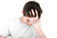 Sorrowful young man. Portrait on the white background Stock Photos