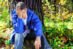 Sorrowful young man Royalty Free Stock Images