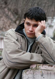 Sorrowful Young Man. Young male model in an autumnal park stock image