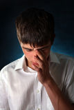 Sorrowful Young Man Portrait. Sorrowful Teenager Portrait on the Dark Background Stock Photos