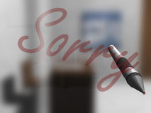 Sorry. Pen writing Sorry on a glass screen in an office Stock Photos