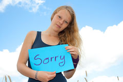 Sorry. Young women shows shield: Sorry Stock Photography