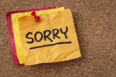 Sorry - apology on sticky note. Sorry apology - handwriting on a orange sticky note Royalty Free Stock Photography