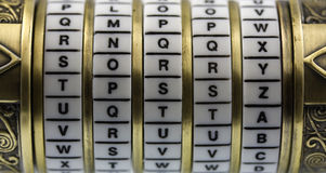 Sorry as password to combination puzzle box. Sorry word set up as a password to combination puzzle box (cryptex) with rings of letters; selective focus Stock Photos