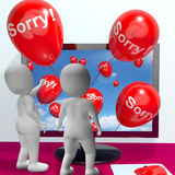 Sorry Balloons From Computer Showing Online Apology Or Remorse. Sorry Balloons From Computer Show Online Apology Or Remorse Stock Photos