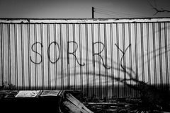 Sorry in black and white. Sorry graffiti in in train stock photography
