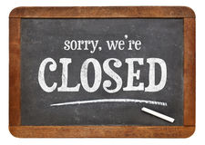Sorry, we are closed blackboard sign. Sorry, we are closed - text on a vintage slate blackboard Stock Image
