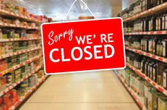 Sorry we are closed label on an abstract Supermarket background. Sorry we are closed label on a blur Supermarket background Stock Photography