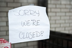 Sorry We Are Closed. A sorry we're closed sign hanging at a food stop that was flooded Stock Photo