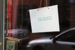 Sorry we are closed - shop window. Sorry we are closed. open/close cartel on a small shop door Stock Photos