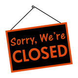 Sorry we are closed sign. A black and orange sign with the words Sorry we are closed sign isolated on a white background Stock Image