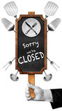 Sorry we are Closed - Sign with Hand of Waiter. Hand of waiter with glove holding a blackboard with text, Sorry we are closed, white plate, silver cutlery and stock illustration