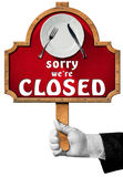 Sorry we are Closed -  Sign with Hand of Waiter Stock Photo